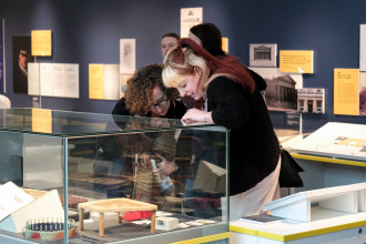 Two people looking at an exhibit at the Liverpool Museum